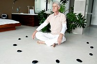 Senior man meditating in a lotus position
