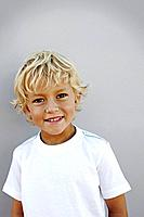 Portrait of smiling boy 7_9 in t_shirt, studio shot