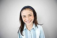 Portrait of smiling girl 10_12, studio shot