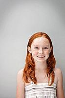 Portrait of smiling redhead girl 7_9, studio shot