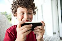 Boy 7_9 playing games on cell phone