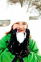 Young girl holding snowball (thumbnail)