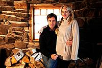 Portrait of mid adult couple in rustic house