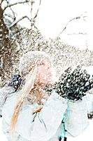 Mid adult woman playing in snow