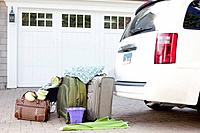 Luggage next to van parked on driveway