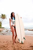 Young woman holding surfboard, portrait (thumbnail)