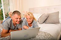 Mature couple using laptop (thumbnail)