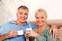 Couple with cups of coffee