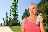 Mature woman runner with water bottle