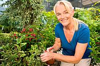 Mature woman gardening (thumbnail)