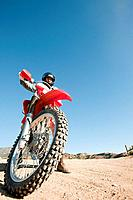 Man riding dirt bike on dirt track