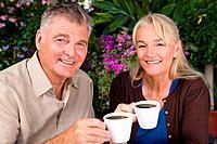 Mature couple having coffee