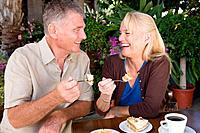 Mature couple having cake