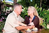 Affectionate mature couple in cafe