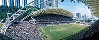 Interior New Government Stadium during the 1994 Rugby Sevens event. Crowds. Players. Corner angle.