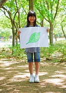 Girl holding drawing of leaf