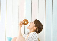 Woman eating bagel