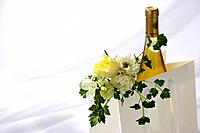 Bag containing wine and flowers