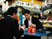 Businessmen eating lunch together outdoors
