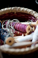 Basket of spools of thread