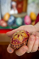 Hand holding a Pisanki or Polish decorated egg