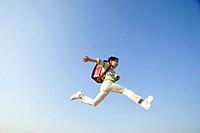Schoolgirl Leaping Across Sky