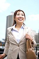 Businesswoman walking in financial district