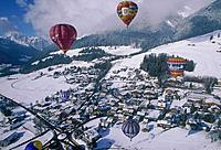 Unipart International Hot Air Balloon Festival 1998. Balloons. Town. Mountains.