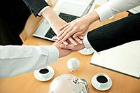 Business partners with hands together