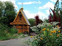 Orthodox wooden chapel with a campanile and the gilt dome 3