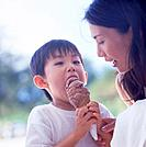 Mother and son holding ice cream
