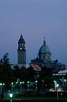 Intramuros. View of Manila cathedral. At dusk. Dome. Tower. Statues. Pink sky.