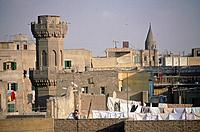 View over rooftops of old buildings of Islamic Cairo. Washing hanging out. Man.