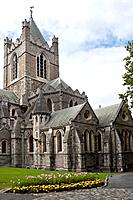 Exterior view from the south, of Christ Church Cathedral tower, and with lawn and flowerbeds, Dublin, Southern Ireland