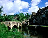 Historical english village with packbridge crossing the Bybrook.