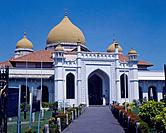 Georgetown. Majid Kapitan Kling mosque. White buildings with yellow domes. Path leading to entrance