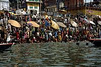 Worshippers taking a ritual bath at the Holy site on the River Ganges at Benares. The River is believed sacred by Hindus.