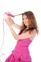 Charming brunette curls her hair.