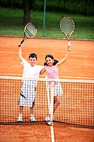 Young Tennis Players Celebrating