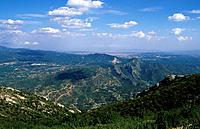 Serrated mountain. View from top over plain and mountain landscape. Geography _ physical