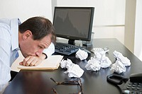 Businessman with face down on desk