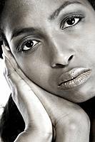 Dark female model resting on her hands