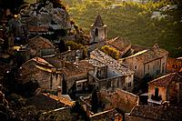 View overlooking a medieval town on a hilltop.