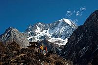 Trekkers stand and admire the view by a chorten near Samogaon