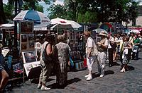 Montmartre. Place du Tertre. Square. Art stalls. People.