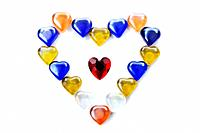 Collection of colorful glass heart shapes drawing another big heartshape, studio shot, white background
