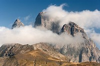Pic du Midi d'Ossau (France) in the clouds, view from the Tena Valley in the Spanish province of Huesca