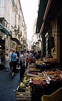 Amalfi coast. Narrow street in town. Market. Stalls. Fruit and vegetables