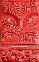 Close_up detail of traditional Maori carved wood panel