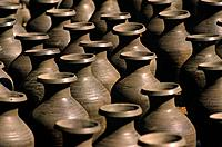 Pottery objects and household wares are made by hand and laid out in the hot sun to dry.